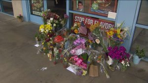 Flowers were left at the Quiznos owned by Patel during a news conference about the search for his killer on June 10, 2015. (Credit: KTLA)