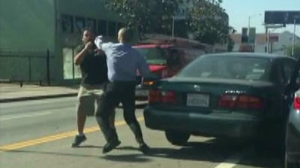 A witness captured cellphone video of a road-rage incident involving two men on a street in Hollywood on Monday, June 8, 2015.