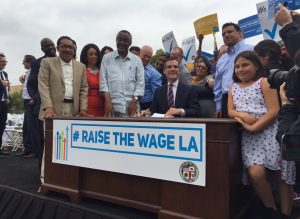 The mayor's office provided this image on June 13, 2015, of L.A. Mayor Eric Garcetti signing a measure into law increasing the minimum wage.
