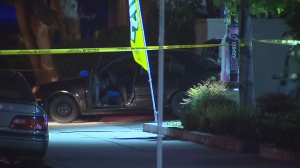Homicide detectives responded to a fatal shooting in Lakewood on June 11, 2015. The victim was found shot in his car. (Credit: KTLA)