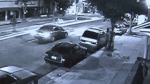 Surveillance video shows one of two cars wanted in connection with a fatal crash that left a 31-year-old mother of three dead on June 10, 2015.