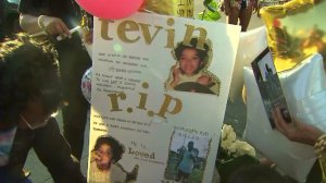 This sign was displayed at a June 1, 2015, vigil for a 19-year-old killed at a car wash in South L.A. four days earlier. (Credit: KTLA)