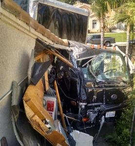 A furniture delivery truck crashed into a home in Highland after the emergency brake failed on June 15, 2015. (Credit: San Bernardino County Sheriff's Department)