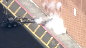 A bomb squad robot blows up an object after a police shooting in Studio City on July 24, 2015. (Credit: KTLA)