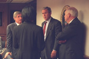 President George W. Bush speaks with Vice President Dick Cheney and members of his senior staff on Tuesday, Sept. 11, 2001.