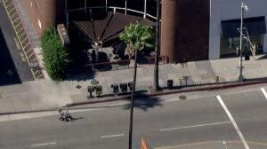 A bomb squad robot approaches an apparent dead body on Ventura Boulevard in Studio City on July 24, 2015. (Credit: KTLA)