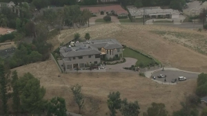 Chris Brown's Tarzana home is seen on July 15, 2015, after it was robbed. (Credit: KTLA)