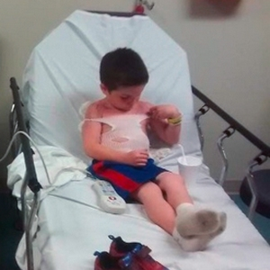 Five-year-old Trae can be seen examining the burns on his chest in a photo from a GoFundMe page created for the family.