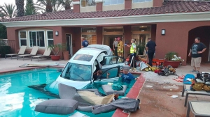 A car landed in a pool after plowing through a building in Camarillo on July 1, 2015. (Credit: Capt. Mike Lindbery/VCFD)