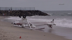 A plane crashed in Carlsbad on July 4, 2015, injuring a 12-year-old boy. (Credit: OnScene)