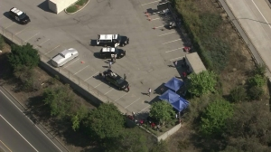 Staff appeared to be congregating under tents in a far corner of the parking lot while the evacuation continued. (Credit: KTLA)