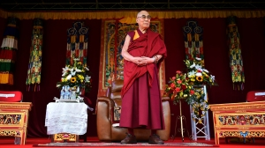 The Dalai Lama takes to the stage to address the faithful in Aldershot on June 29, 2015, which has a large Nepalese Buddhist community made up mainly of serving and retired Gurkha soldiers. (Credit: BEN STANSALL,BEN STANSALL/AFP/Getty Images)