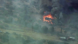 A home in Baldy Mesa goes up in flames in the North Fire on July 17, 2015. (Credit: KTLA)