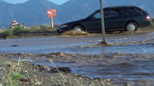 A flooded intersection in the Lake Los Angeles area is seen on July 29, 2015. (Credit: KTLA)