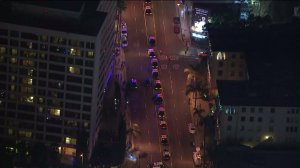 Dozens of law enforcement vehicles are seen on Sunset Boulevard after large crowds gathering for a free Future concert prompted a closure in front of West Hollywood's House of Blues on July 23, 2015. (Credit: KTLA)
