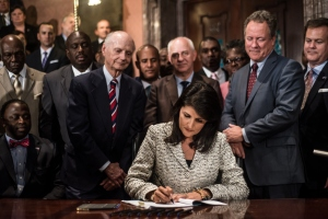 South Carolina Gov. Nikki Haley signs a bill to remove the Confederate battle flag from the state house grounds July 9, 2015, in Columbia, South Carolina. Debate on the flag was reignited three weeks ago after the mass murder at Emanuel AME Church in Charleston. (Credit: Sean Rayford/Getty Images)