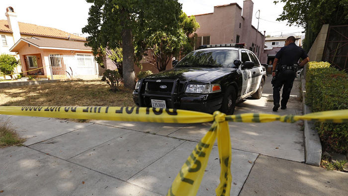 An investigation was ongoing at a Glendale home in the 600 block of Alexander Street on June 29, 2015. The bodies of a couple were found in the home the day before. (Credit: Al Seib / Los Angeles Times