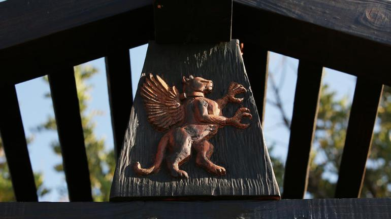 The Griffith Park Teahouse is decorated with a hand-carved image of a mythological griffin. In honor of Los Angeles, it is part red-tailed hawk (common to the area) and part mountain lion (like P-22, the famous mountain lion spotted in the area). The creature is shown wearing a tracking collar. (Credit: Al Seib / Los Angeles Times)