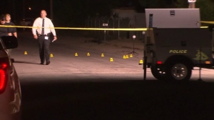 Officials investigate on July 30, 2015, the fatal shooting of a boy in Highland. (Credit: KTLA)