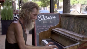 Donald Gould, a homeless veteran, is seen playing a piano in a video that has gone viral on social media. (Credit: Sly Dylan/YouTube)