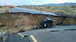 A vehicle is seen at the site of a bridge collapse in Desert Center, Calif., or Sunday, July 18, 2015. (Credit: KMIR)