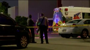 Officials are seen outside a Louisiana theater where a shooting occurred on July 23, 2015. (Credit: KATC)