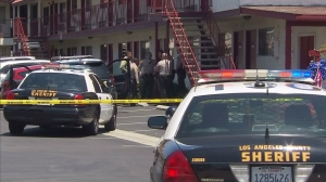 A woman was detained after a teenager was fatally shot at a hotel in Rosemead on July 27, 2015. (Credit: KTLA)
