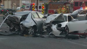 Two crumpled vehicles are seen at in intersection in Rosemead after a fatal crash on Friday, July 24, 2015. (Credit: KTLA)