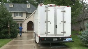 Investigators converged on the Zionsville, Indiana, home owned by longtime Subway spokesman Jared Fogle on Tuesday, July 7, 2015, in a probe that authorities have declined to discuss publicly. (Credit: Zach Myers/WXIN)