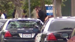 An investigation was underway after police shot a man in the Mid-Wilshire area on July 9, 2015. (Credit: KTLA)