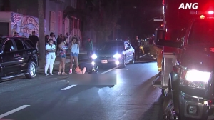 A female pedestrian was seriously injured in South L.A. on July 12, 2015, when she was struck by a hit-and-run driver while crossing the street. (Credit: ANG)