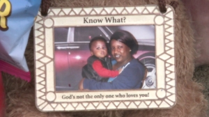 The victim, 1-year-old Dylan Harris, is seen in a photo left at a memorial for the young boy. (Credit: WGN)