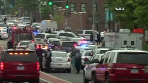 Dozens of police vehicles are seen at the scene of a possible shooting at a Washington navy yard on July 2, 2015. (Credit: WJLA)