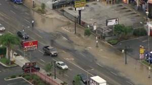 A broken water main floods a street in Hollywood on July 9, 2015. (Credit: KTLA)