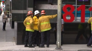 City firefighters worked Aug. 21, 2015, outside a building where an explosion occurred the previous night. (Credit: KTLA)