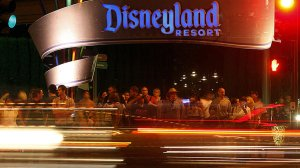 Visitors to Disneyland wait to cross Harbor Boulevard on the eastern side of the famed theme park in Anaheim. (Credit: Luis Sinco / Los Angeles Times)