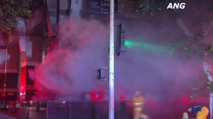 Smoke billowed out of the basement of a downtown L.A. office building following an explosion on Aug. 20, 2015. (Credit: ANG)