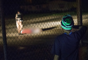 A young boy looks at a man lying in a parking lot with what appears to be gunshot wounds after a barrage of gun fire erupted along West Florrisant Street during a demonstration to mark the 1-year anniversary of the shooting of Michael Brown on Aug. 9, 2015, in Ferguson, Missouri. (Credit: Scott Olson/Getty Images)