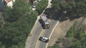 Police and firefighters responded to three small fires in Beverly Glen on Aug. 27, 2015. (Credit: KTLA)