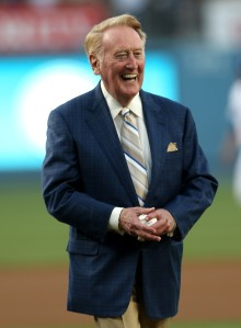 Dodger broadcaster Vin Scully smiles before throwing out the first pitch during ceremonies honoring him on his 64 years of service before the game between the Arizona Diamondbacks and the Los Angeles Dodgers on Aug. 30, 2012, at Dodger Stadium. (Credit: Stephen Dunn/Getty Images)