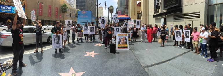 Protesters attend a rally against police violence in Hollywood on Aug. 21, 2015. (Credit: KTLA)