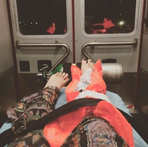 A injured moviegoer posted this image on Instagram from inside an ambulance after patrons fled a movie theater in Newport Beach. (Credit: Kyndall Aldama)