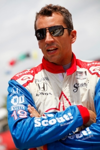 Justin Wilson of England, driver of the #19 Dale Coyne Racing Dallara Honda, stands on pit road during NTT DATA Qualifying for the Verizon IndyCar Series Firestone 600 at Texas Motor Speedway on June 6, 2014 in Fort Worth, Texas. (Photo by Brian Lawdermilk/Getty Images for Texas Motor Speedway)