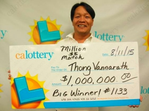 Thong Vannarath is seen holding a California Lottery check for $1 million. (Credit: California Lottery)