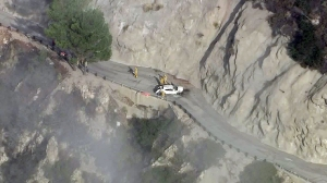 One person was killed when a car crashed down an embankment in the Angeles National Forest on Aug. 18, 2015. (Credit: KTLA)