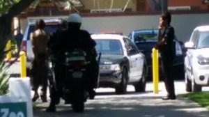 John William Rodenborn, far left, is seen being taken away in handcuffs by police. (Credit: Nancy Lemus/Santa Ana Zoo)