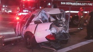 A mangled vehicle is pictured after a three-vehicle, hit-and-run crash that killed one person on Aug. 7, 2015. (Credit: Newspro News)