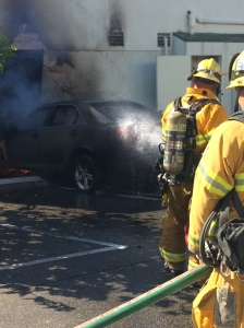 Santa Monica fire crews continued to battle a stubborn blaze that started when a vehicle crashed into the back of a restaurant on Aug. 12, 2015. (Credit: Mark Mester / KTLA)
