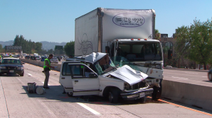 A man and child died after a crash on the northbound 405 Freeway in Van Nuys on Sunday, Aug. 23, 2015. (Credit: KTLA)