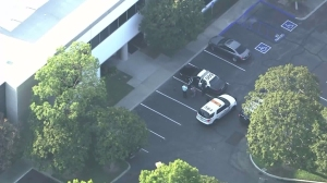Police were responding to the Department of Children and Family Services in Santa Fe Springs after a chemical attack injured a worker on Aug. 19, 2015. (Credit: KTLA)